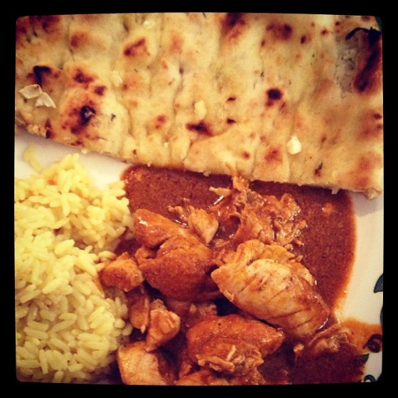 butter chicken, garlic naan, and yellow rice